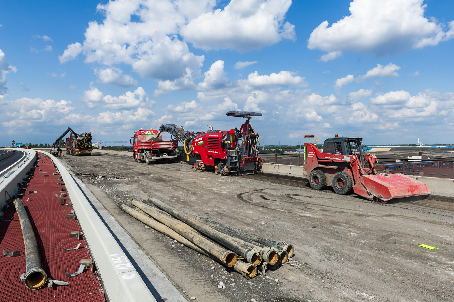 Duisburg bridge renovation with red construction machinery A59 motorway