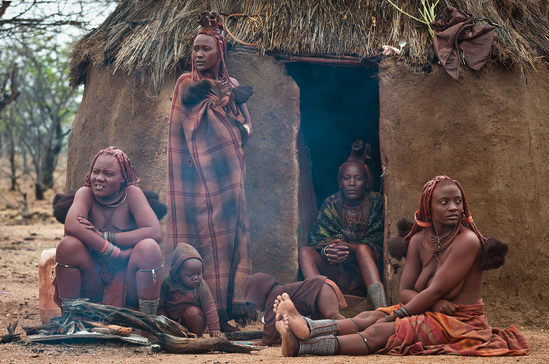 A Himba-family siting in front of their home